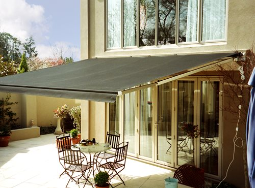 Euro Retractable awning open over backdoor and sitting area