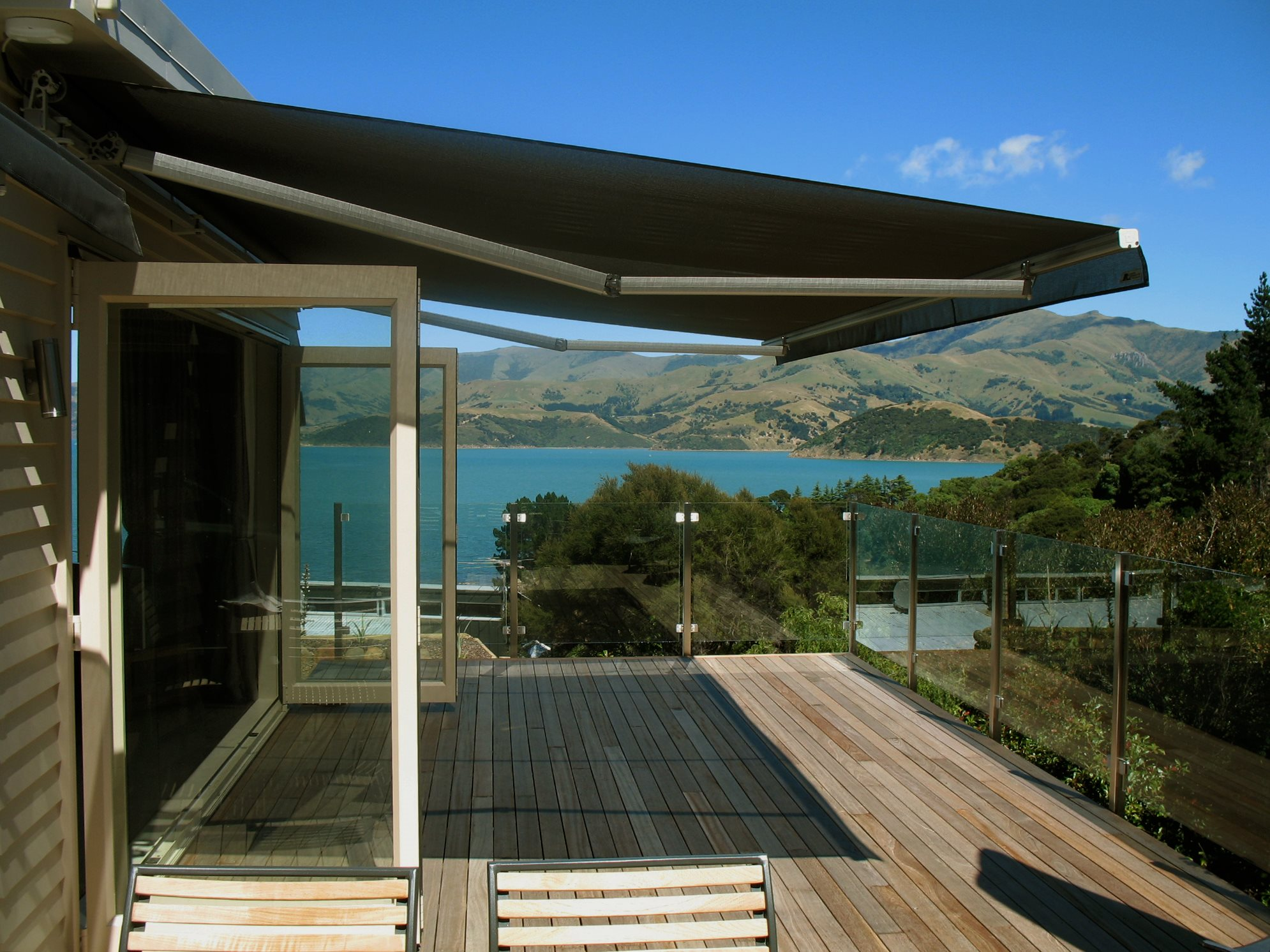 Euro Retractable awning open over balcony beside lake
