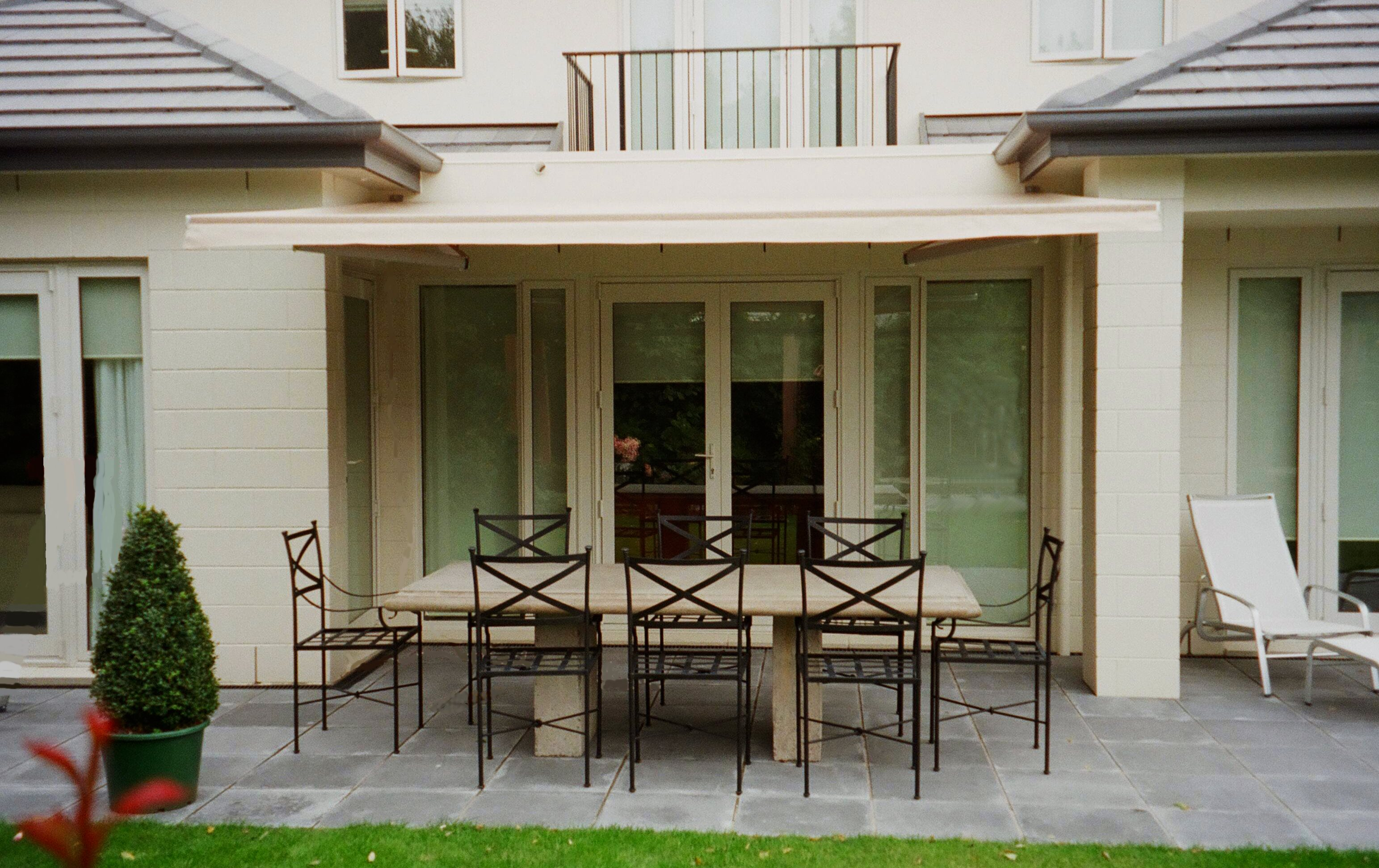 Euro Retractable awning open over outside dining table