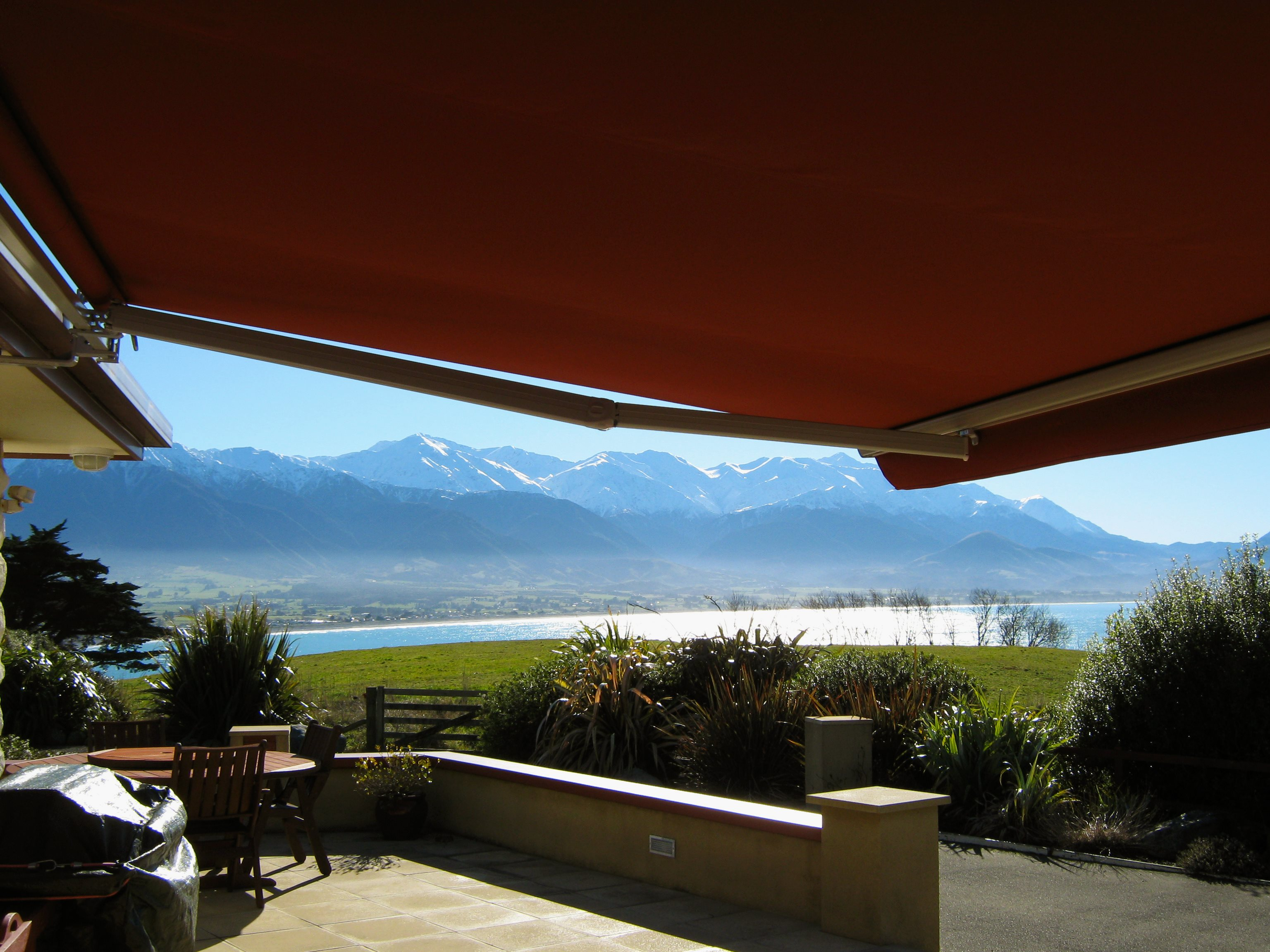 Euro awning  open over porch overlooking mountains