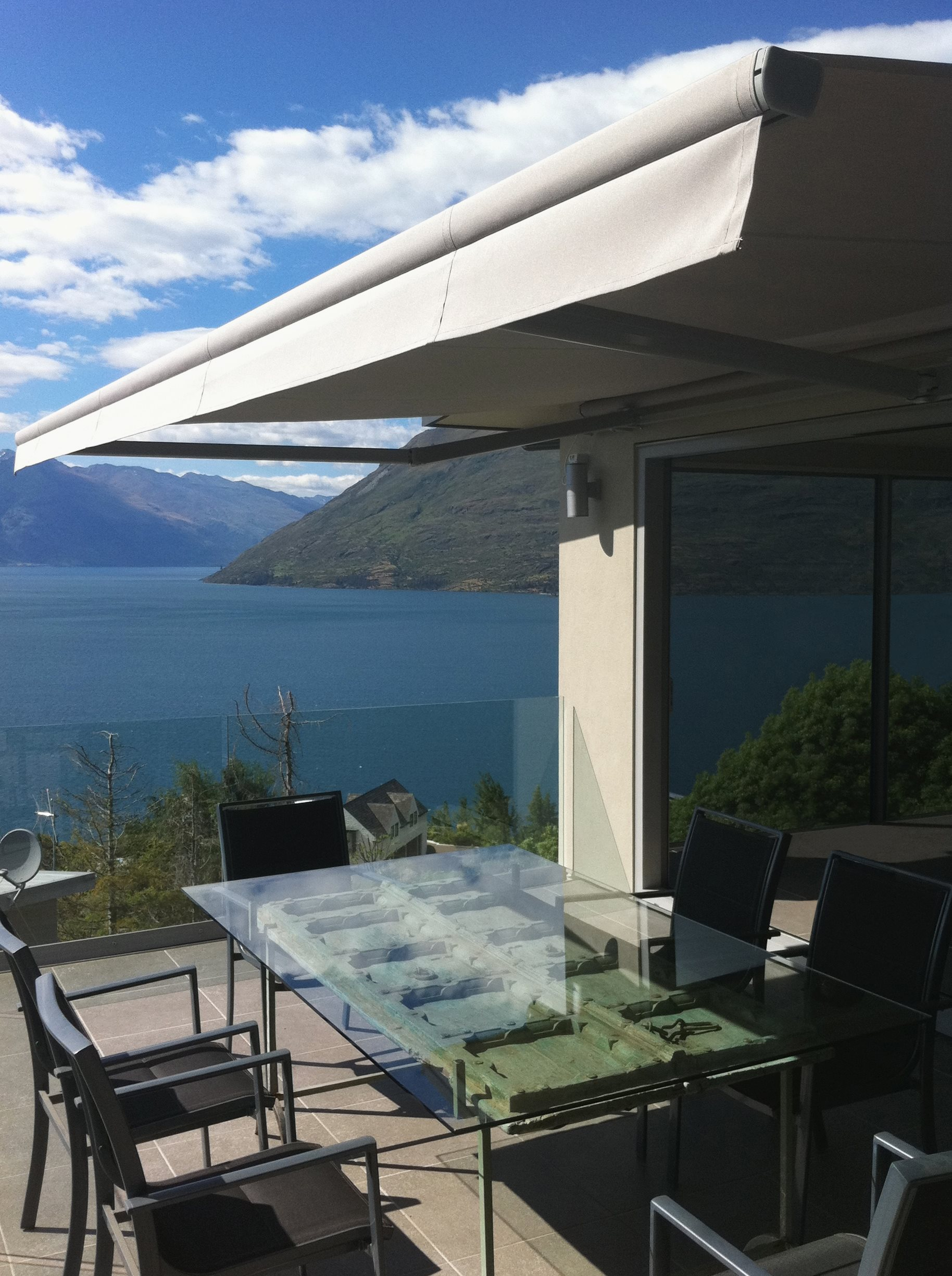 Euro awning open over balcony dining area overlooking Queenstown
