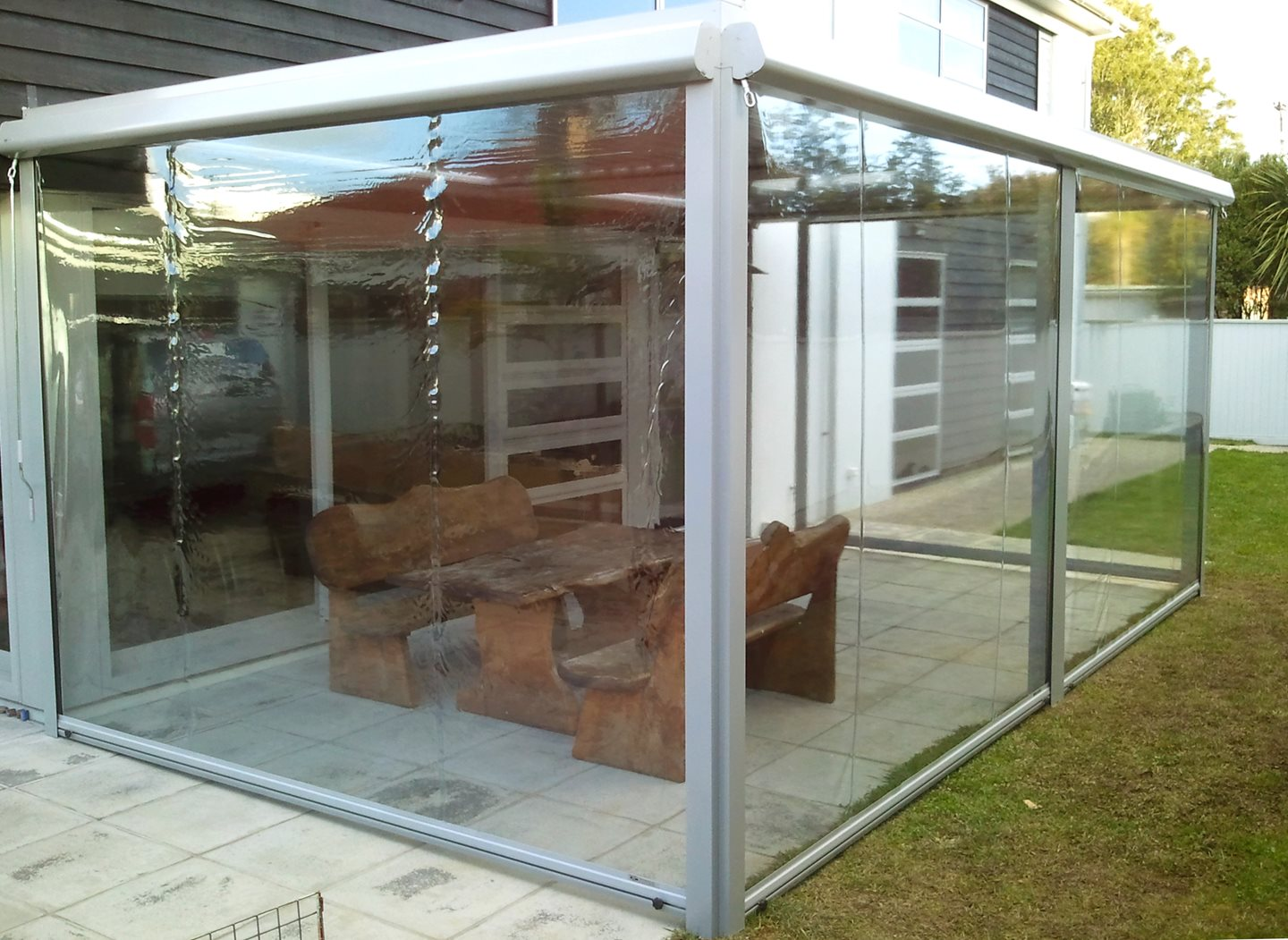Zip Up Outdoor Screen Johnson Couzins Zipper Wiring Diagram See Through Calido Covering Table Beside Back Yard