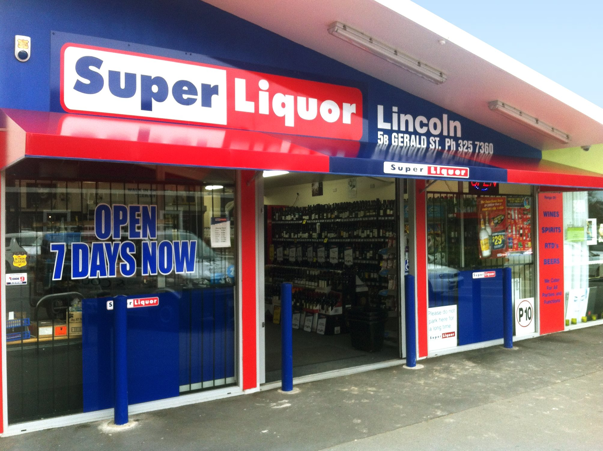 Awnings shading outside of super liquor shop