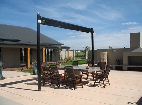 Outdoor canopy closed over dining table