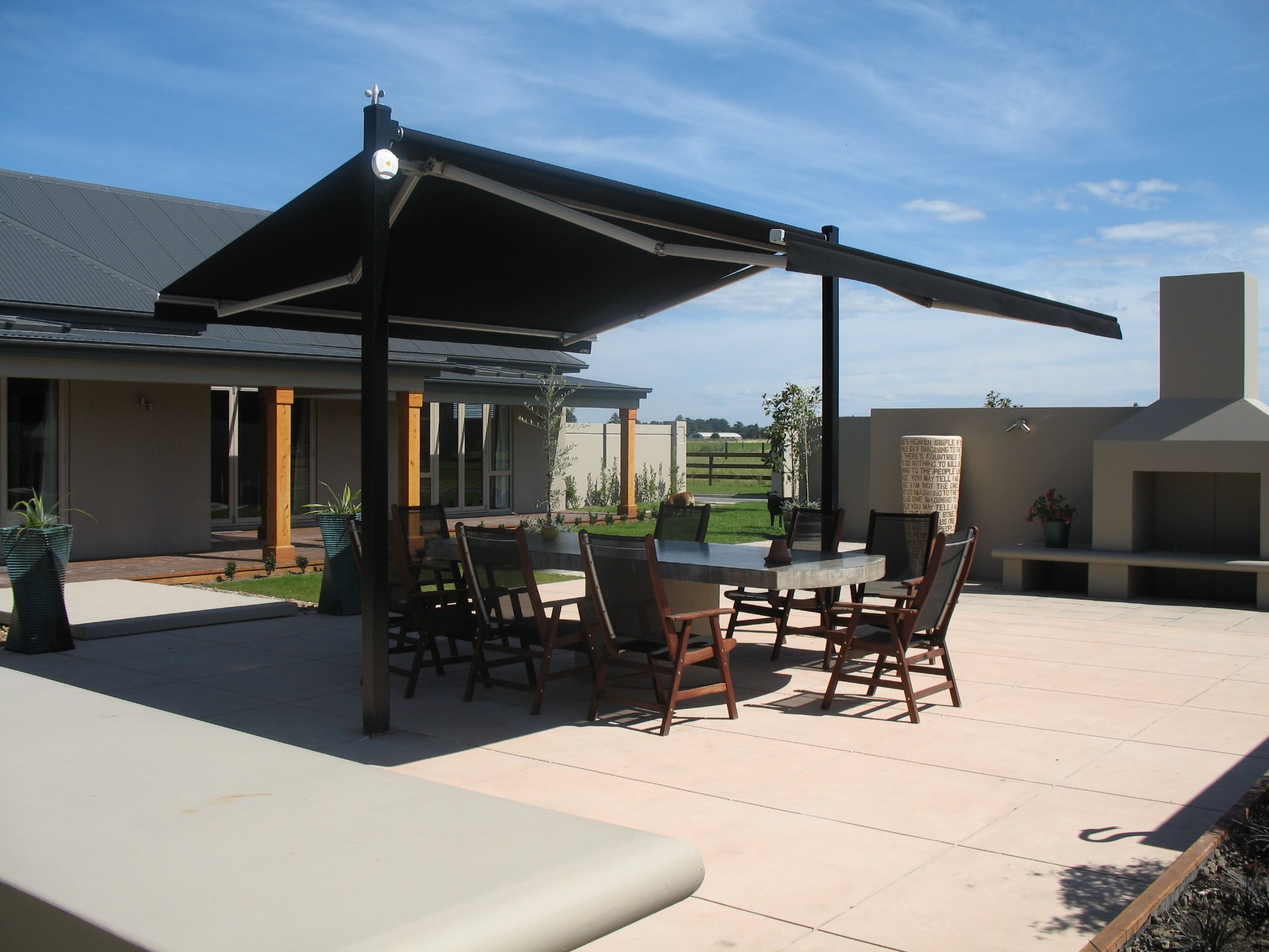 Outdoor canopy open over outdoor dining table
