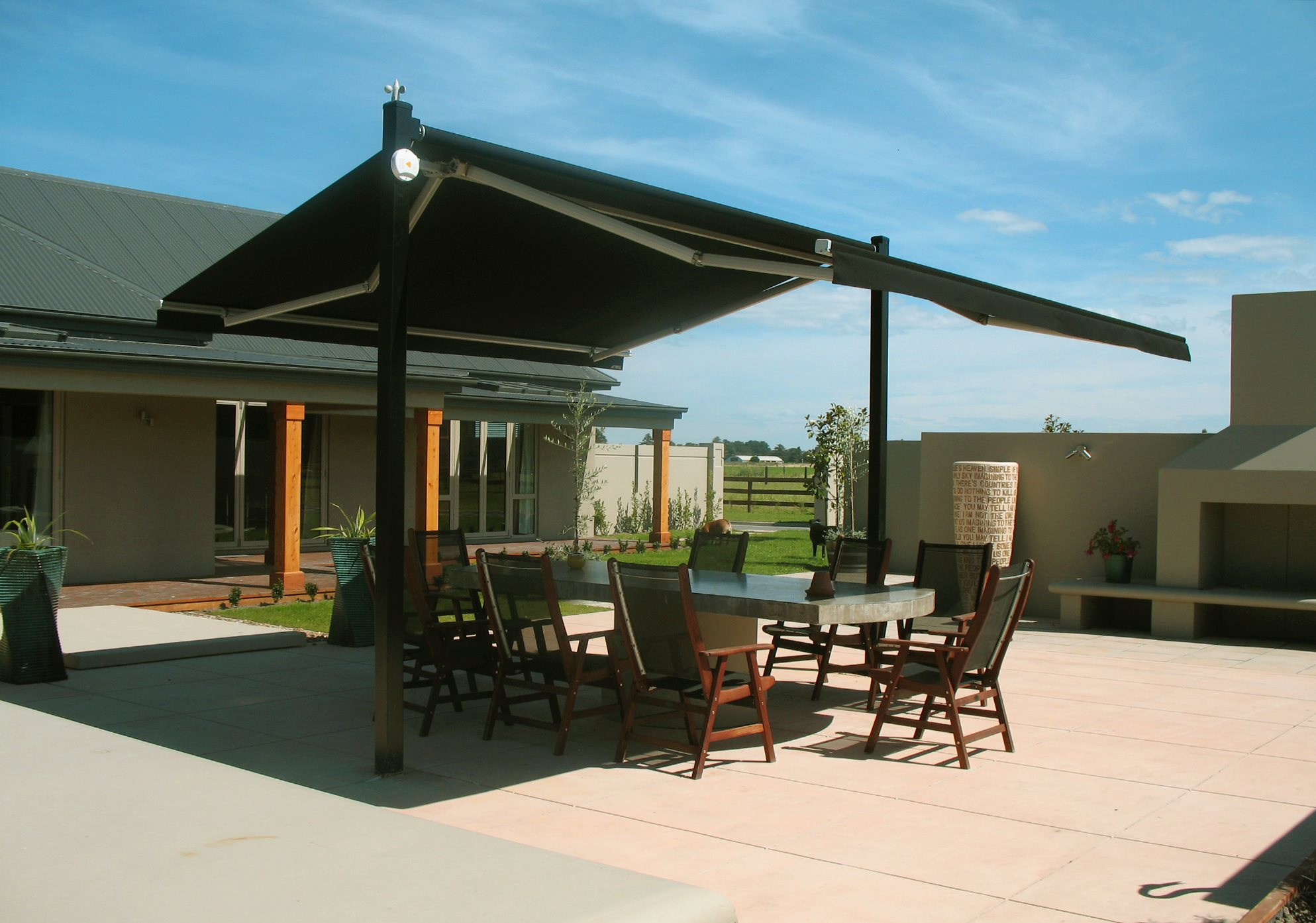 Plaza canopy open providing shade for the outdoor dining table