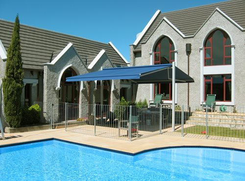 Outdoor canopy over sitting area beside pool