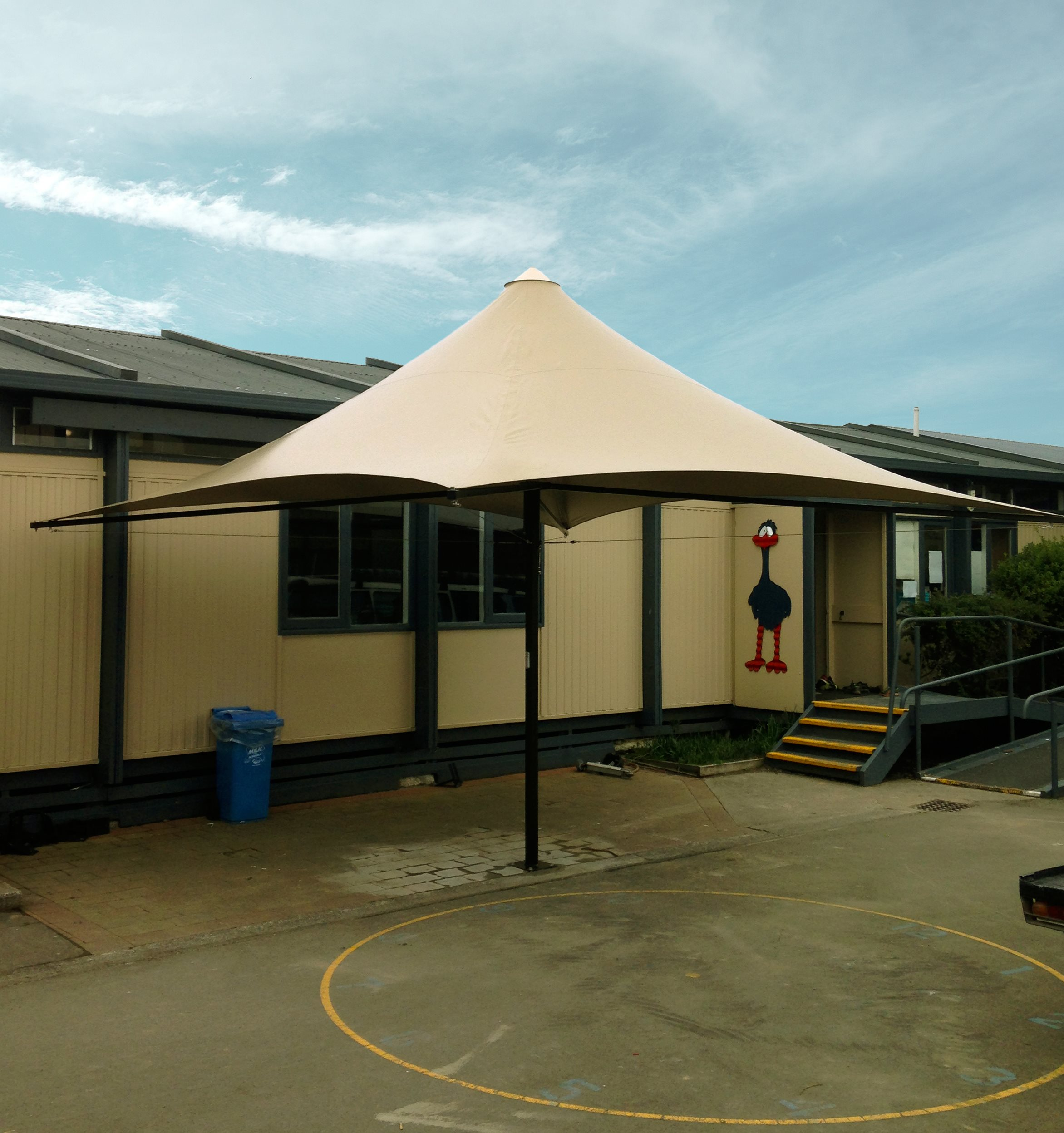 Parasol Umbrella being shading a play area for kids at Leithfield School