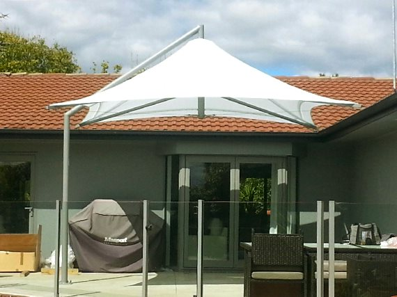 Parasol Umbrella shading porch barbecue and dining table