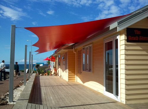 Shade Sails shading a front porch of houses by the beach