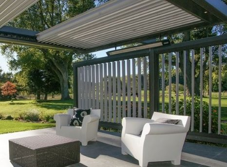 Outdoor heaters hanging over sitting area outside house