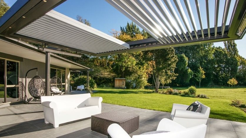 Outdoor heaters hanging on louver structure over sitting area