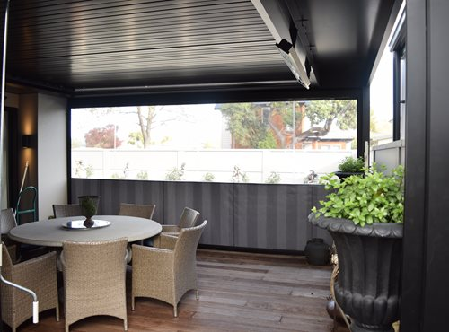 Outdoor heaters hanging on louver structure on outdoor porch and dining area